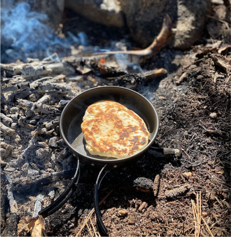 bannock bread cooked on the campfire