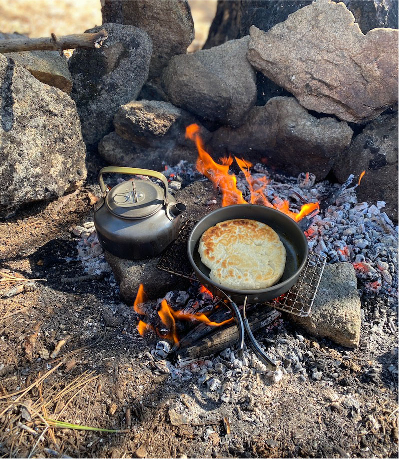 hot water and bannock bread campfire cooking