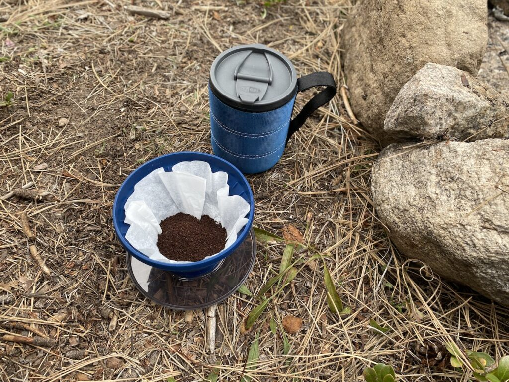 setting up pour over coffee for camp coffee