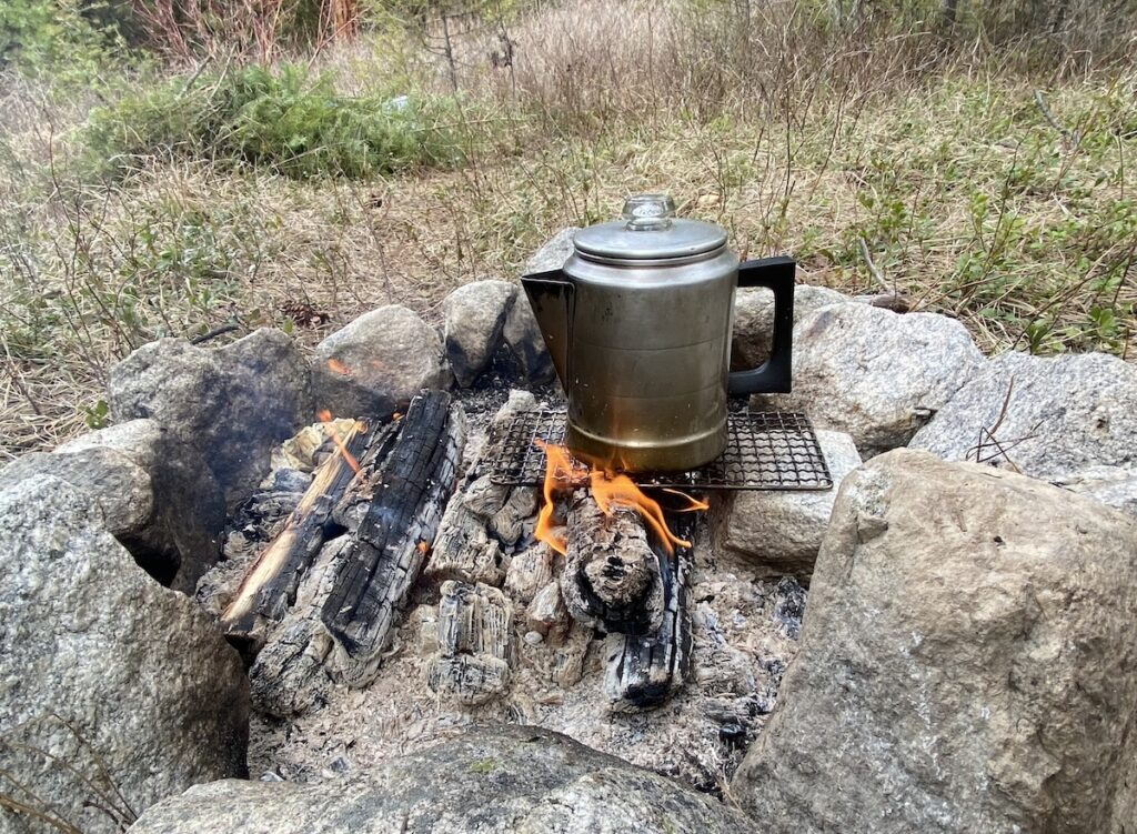 camp coffee pot on the campfire for hot water or campfire coffee