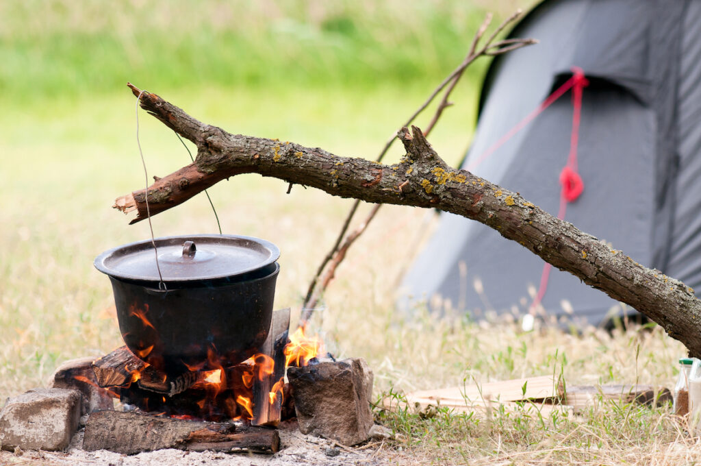 camping meals on a fire in a cook pot