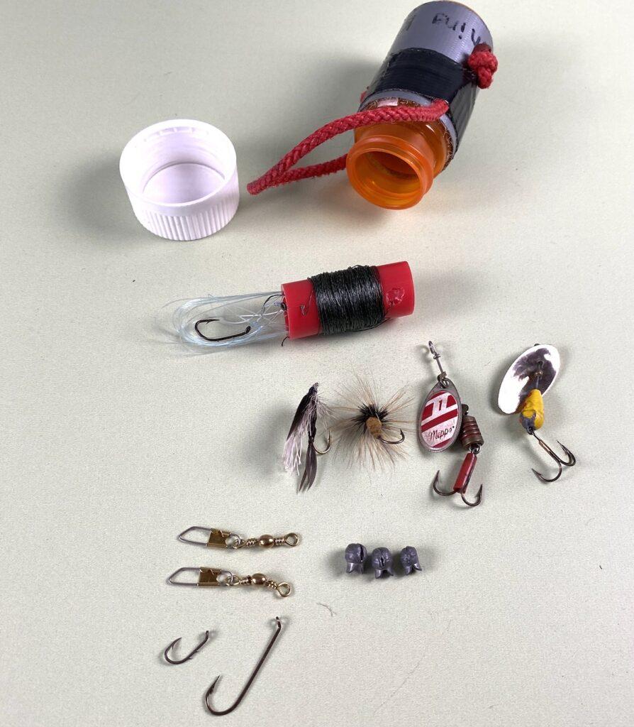 Fishing kit in a prescription bottle.