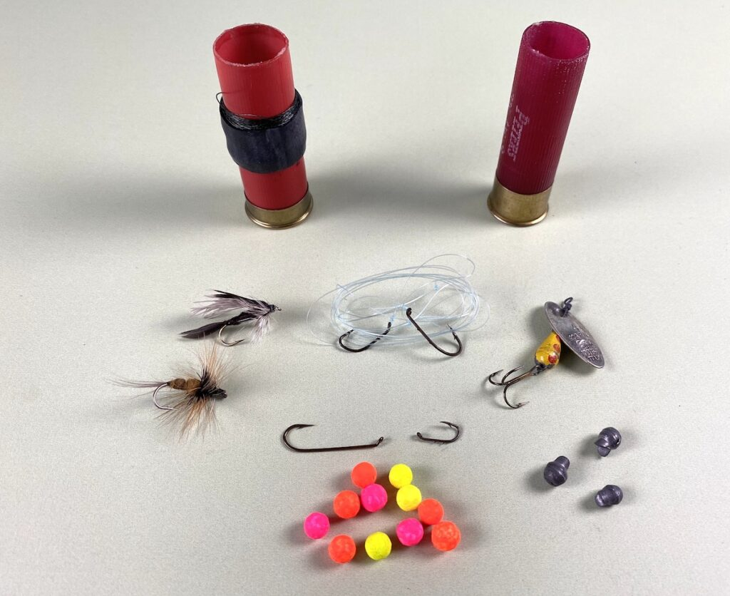 shot shells and fishing lures for a fishing kit