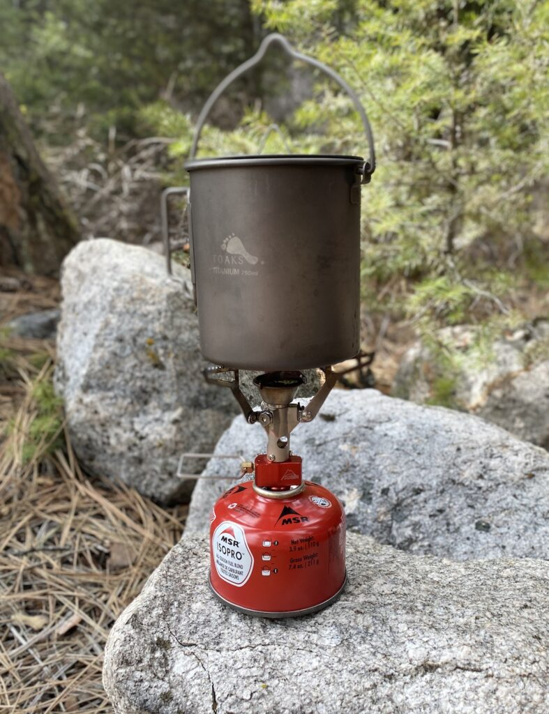 camping stove with a Toaks cooking pot and bale