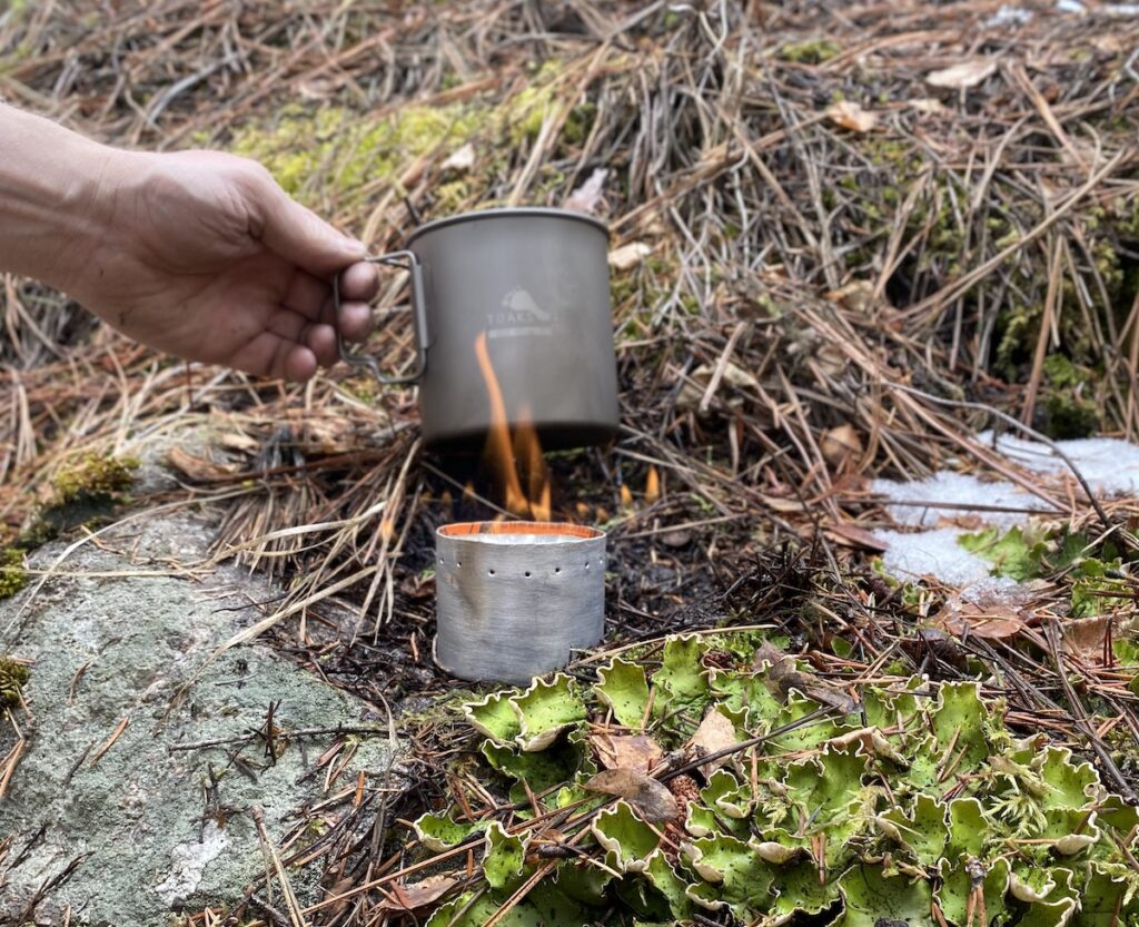 using a diy alcohol stove to boil water in a Toaks pot