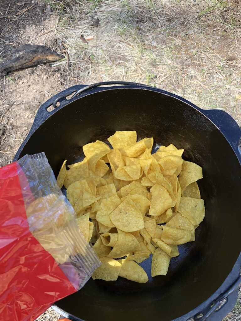 putting tortilla chips in the dutch oven