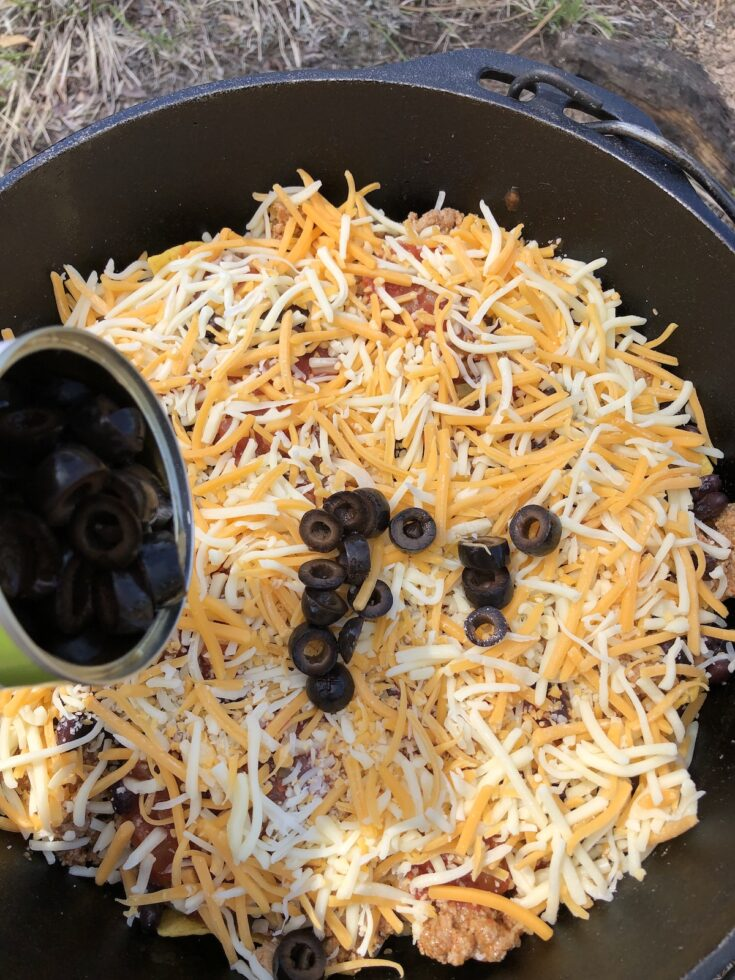 adding black olives to nachos and cheese