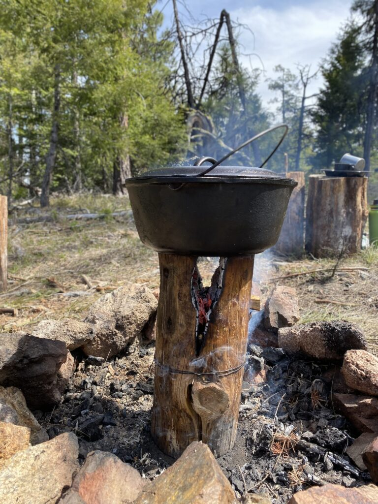 cooking on a fire log with a Dutch Oven