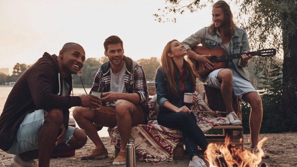 people singing around campfire