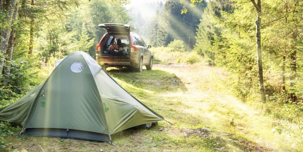 tent-on-the-ground-next-to-a-car