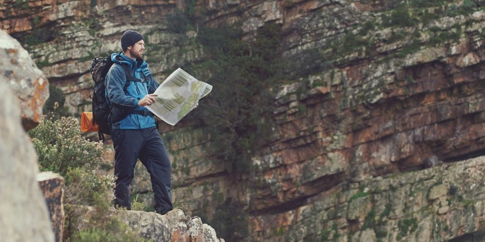 Hiker reading a map