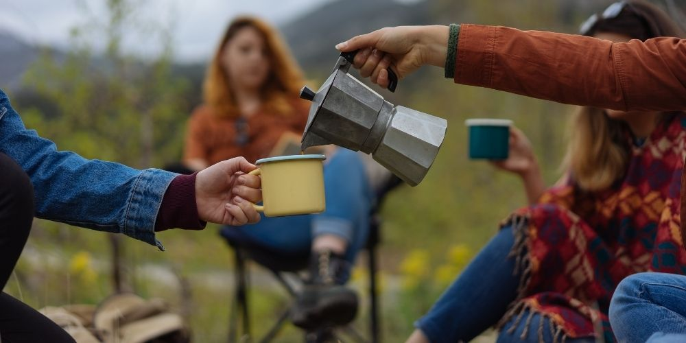 people enjoying coffee while camping