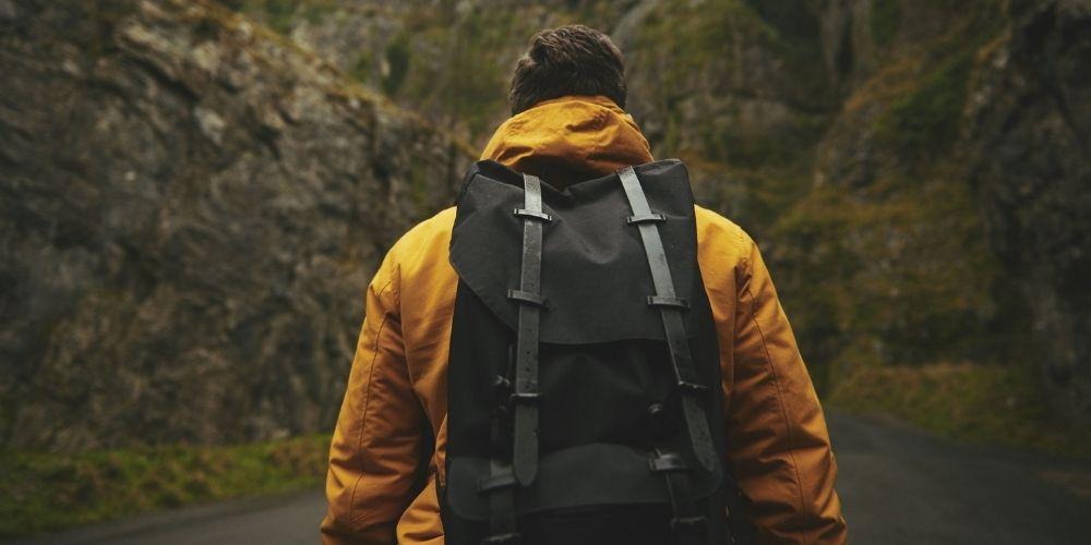 man wearing waterproof backpack